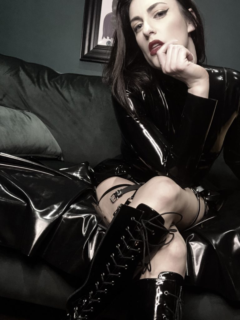 dominant alpha female wearing latex professional domme southwest